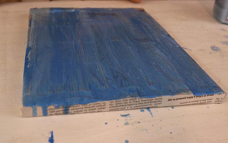 brush-paint-blue-background-newspaper-art